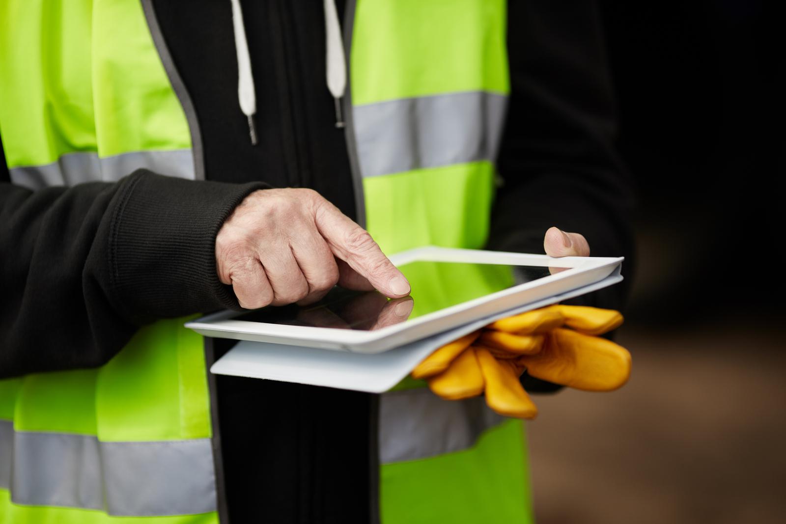 bigstock-construction-worker-using-digi-36701338-1